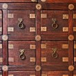 Old wooden vintage chest of drawers - Stock Photo