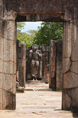 Passage in ruins to Buddha statue. Pollonaruwa, Sri Lanka — Stock Photo