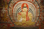 Ancient Buddha image in Dambulla Rock Temple caves — Stock Photo