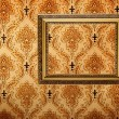 Vintage gold plated picture frame  on retro wallpaper — Stock Photo