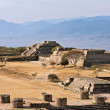 Ancient ruins on plateau Monte Alban in Mexico - Stock Photo