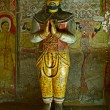 Ancient king image in Dambulla Rock Temple caves, Sri Lanka - Stock Photo