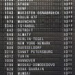 Departure schedule board in asian airport — Stock Photo