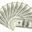 Stock Photo: Hundreds of dollars spread on white background
