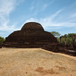 Ancient Buddhist dagoba (stupe) Pabula Vihara.  Sri Lanka - Stock Photo