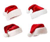 Santa kapelusze na białym tle — Zdjęcie stockowe