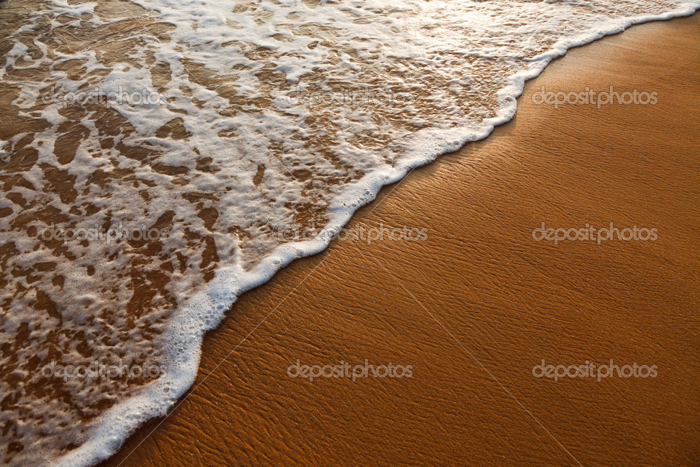 Wave surging on sand on beach. Lots of copyspace — Stock Photo #4521112