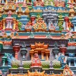 Sculptures on Hindu temple tower - Stock Photo