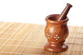 Wooden mortar with pestle — Stock Photo