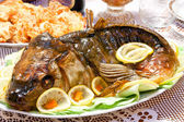 Fish baked with greens closeup — Stock Photo