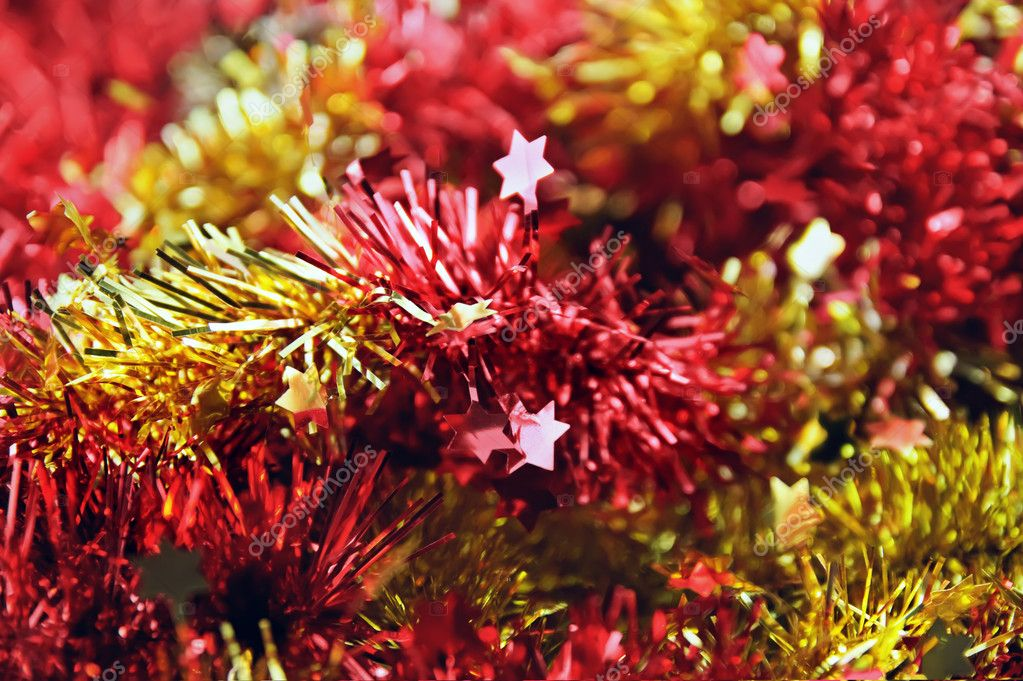 Background from red and yellow christmas tinsel — Stock Photo #4292168