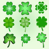 Set of stylized clover leaves — Stock Vector