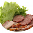 Meat, sausage and salad leaves — Stock Photo