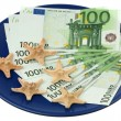 Stock Photo: Euro and starfishes