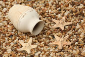 Jug and starfishes — Stock Photo