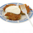 Potato fritters with sour cream — Stock Photo