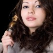 Attractive young woman in a fur coat — Stock Photo