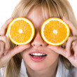 Portrait of the funny young woman with oranges. Isolated — Stock Photo