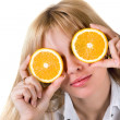 Portrait of the funny girl with oranges. Isolated on white — Stock Photo