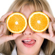 Stock Photo: Portrait of the funny girl with oranges over white