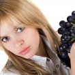 Portrait of the girl with grapes cluster. Isolated — Stock Photo