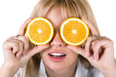 Portrait of the funny young woman with oranges. Isolated — Stok fotoğraf
