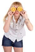 Portrait of the funny girl with oranges. Isolated — Stock Photo