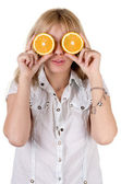 Funny girl with oranges. Isolated on white — Stock Photo