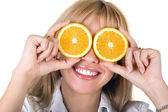 Portrait of the funny smiling girl with oranges. Isolated — Stock Photo