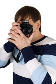 Young man with a camera. Isolated on white — Stock Photo