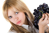 Portrait of the girl with grapes cluster. Isolated — Stockfoto