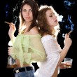 Portrait of the two girlfriends with a cigars — Stock Photo