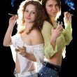 Two smiling pretty girlfriends with a cigars — Stock Photo