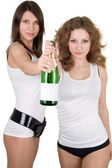 Two beautiful girls with a champagne bottle. Isolated — Stok fotoğraf