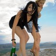 Two girls with a champagne bottle — Stock Photo