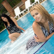 Two playful girlfriends in pool — Stock Photo #4906510