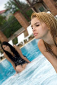 Portrait of the two girls in pool — Стоковое фото