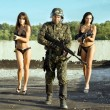 Soldier and two women — Stock Photo