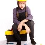 LIttle master girl sitting on tool box — Stock Photo