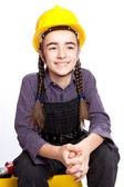 Maestro ragazzina seduta sulla cassetta degli attrezzi — Foto Stock