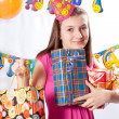 Foto Stock: Birthday girl and gifts