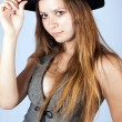 Portrait of the beautiful and stylish girl in a hat. — Foto de Stock