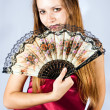 Portrait of the beautiful girl with a fan. — Stock Photo