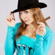 Portrait of the beautiful and stylish girl in a hat with a cigar — Stock Photo