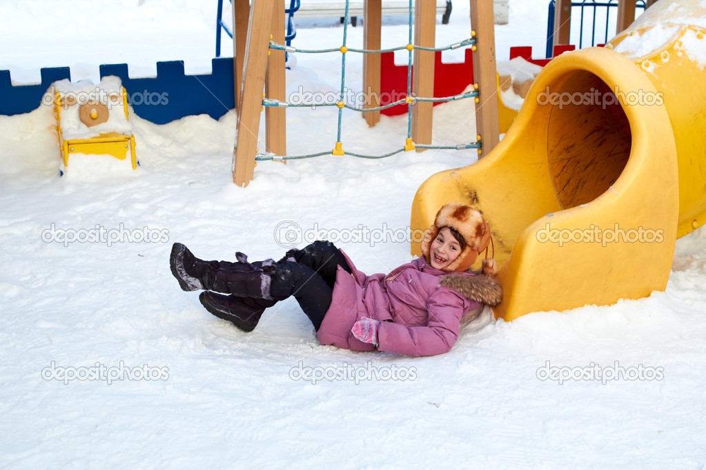 The girl just came from tube at a childrens play area in winter — Stock Photo #4701746