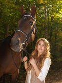 Girl and horse — Stock Photo