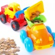 Toy loader loads the coin into the truck. — Stock Photo