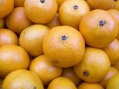 Tangerines on a counter macro3 — Stock Photo