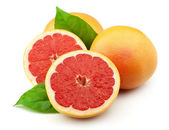 Grapefruit with leaves — Stock Photo