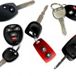 Five Car keys with remote control isolated over white background — Stock Vector #4617464